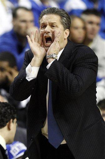 Kentucky head coach John Calipari shouts instructions to his team during the first half of an NCAA college basketball game against Lamar in Lexington, Ky., Wednesday, Dec. 28, 2011. (AP Photo/James Crisp)