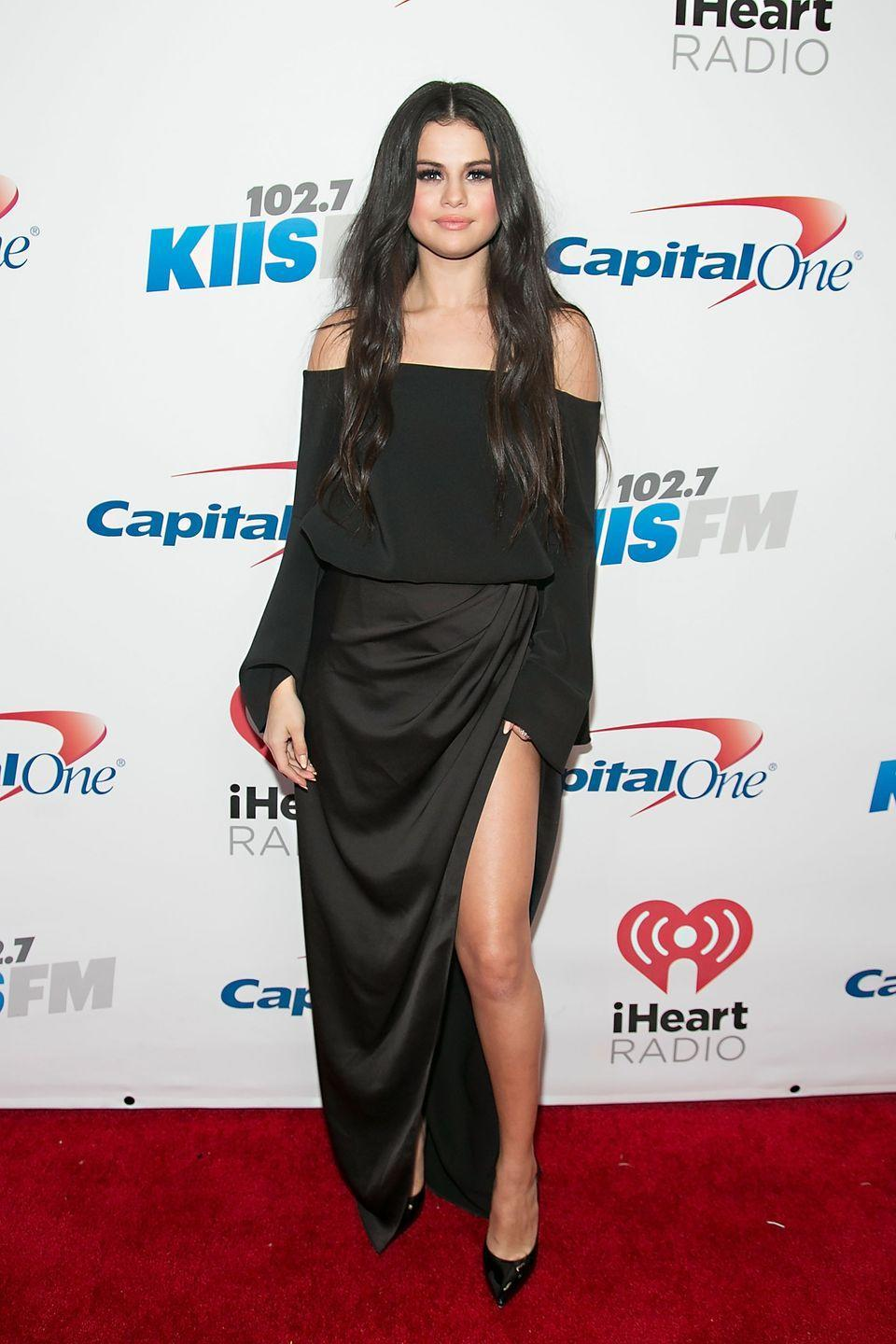 <p>In a Camilla and Marc top and black slit skirt at Jingle Ball 2015 in Los Angeles. </p>