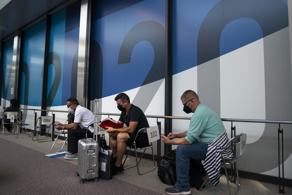 FILE - In this July 10, 2021, file photo, visitors wait in the holding area to take a COVID-19 test at the Narita International Airport in Narita, near Tokyo. (AP Photo/Jae C. Hong, File)