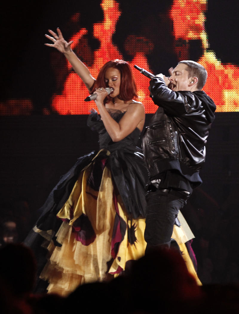 FILE - In this Feb. 13, 2011 file photo, Rihanna, left, and Eminem perform at the 53rd annual Grammy Awards in Los Angeles. Rihanna and Eminem are among the top competitors at the Billboard Music Awards on Sunday May 22.  (AP Photo/Matt Sayles, file)