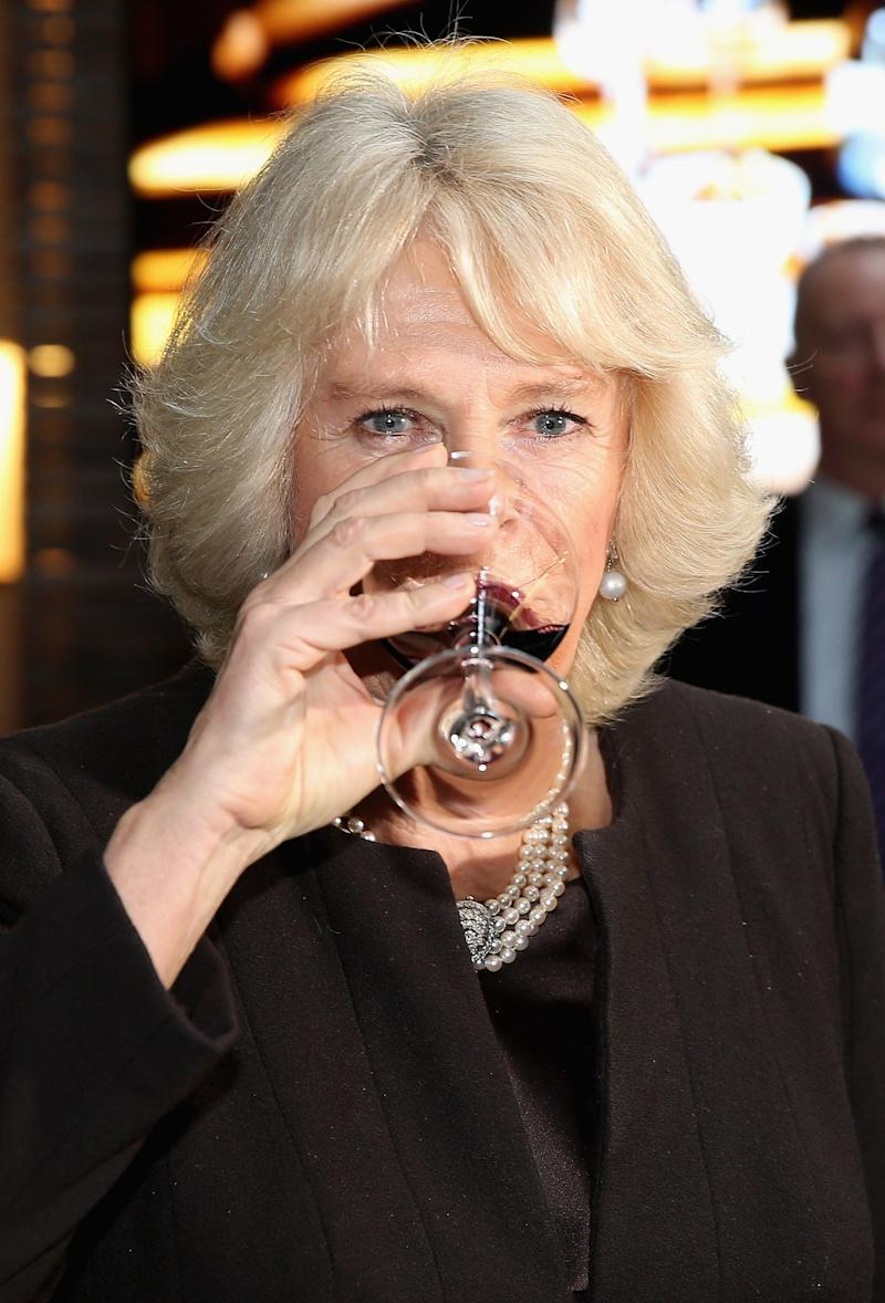 Camilla Parker Bowles sampling a glass of Australian wine during an Australian Day Reception at the Violin Factory in London, January 2015.