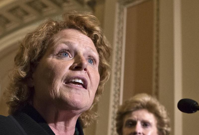 FILE - In this June 10, 2013 file photo, Sen. Heidi Heitkamp, D-N.D. speaks during a news conference on Capitol Hill in Washington. The Senate's record-setting 20 women, emboldened by their recent political and legislative successes, are determined to swell their ranks this November. They're providing campaign and fundraising help to the Republican and Democratic female candidates from West Virginia, Kentucky, Georgia and Oregon looking to smash a few glass ceilings, and hopefuls from Michigan and Hawaii eyeing an all-female Senate lineup. (AP Photo/J. Scott Applewhite, File)