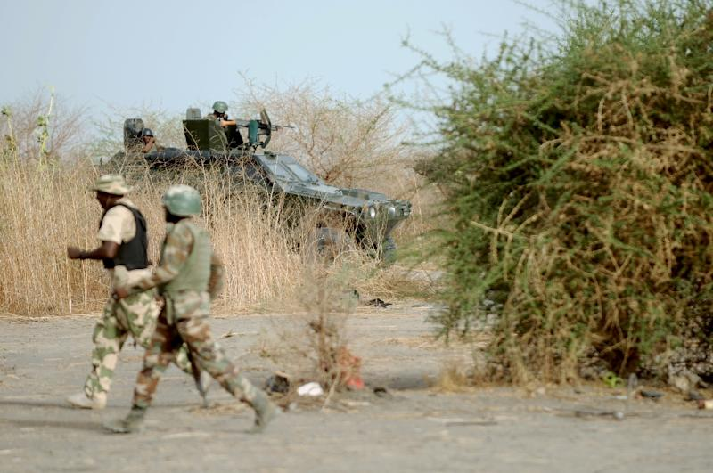 Nigerian soldiers patrol in the north of Borno state close to former Boko Haram camp on June 5, 2013 near Maiduguri (AFP Photo/Quentin Leboucher)