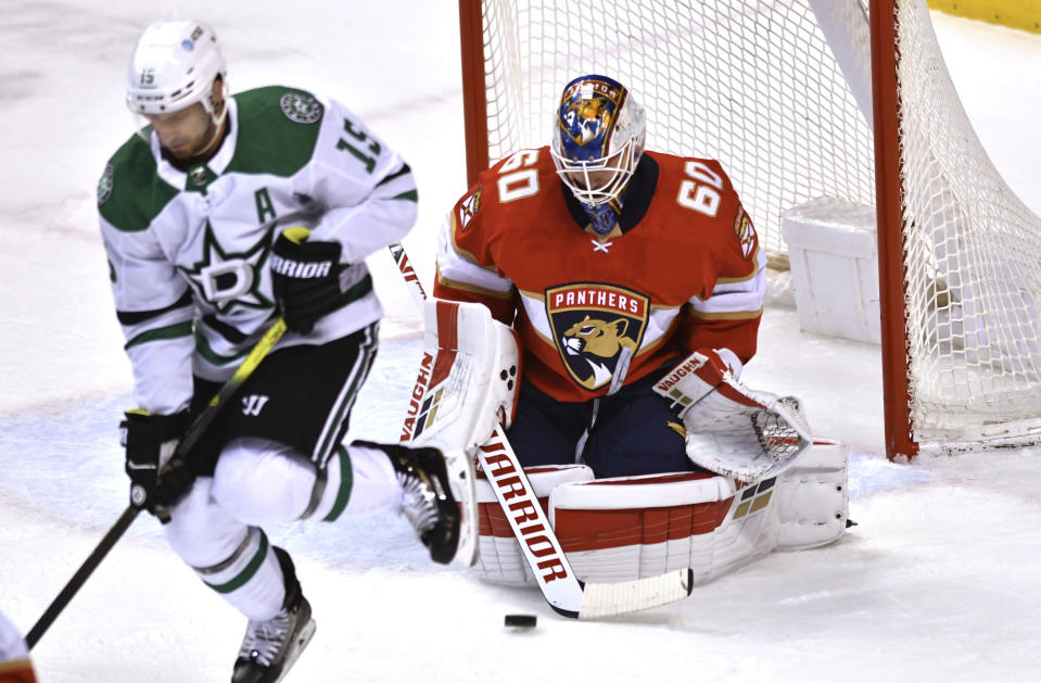 Florida Panthers goaltender Chris Driedger (60) makes a save behind a screen by Dallas Stars' Blake Comeau (15) during the first period of an NHL hockey game Wednesday, Feb. 24, 2021, in Sunrise, Fla. (AP Photo/Jim Rassol)