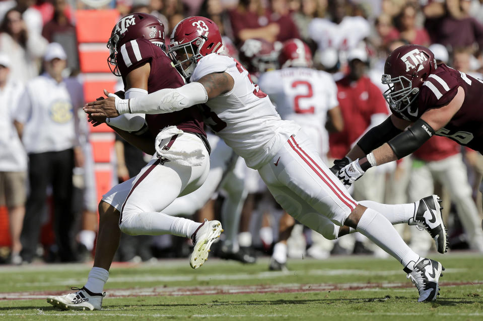 FILE - In this Oct. 12, 2019, file photo, Alabama linebacker Anfernee Jennings (33) tackles Texas A&M quarterback Kellen Mond (11) for a loss during the first quarter of an NCAA college football game, in College Station, Texas. Jennings was selected to The Associated Press All-Southeastern Conference football team, Monday, Dec. 9, 2019.(AP Photo/Sam Craft, File)