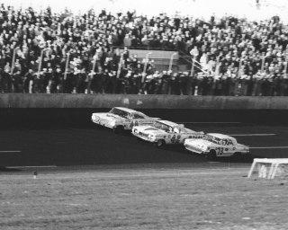Winner Lee Petty (No. 42) edges his Oldsmobile past the Ford Thunderbird of Johnny Beauchamp (No. 73) to win the first Daytona 500. Joe Weatherly (No. 48) was a lap down to the leaders. (Photo by ISC Archives/CQ-Roll Call Group via Getty Images)