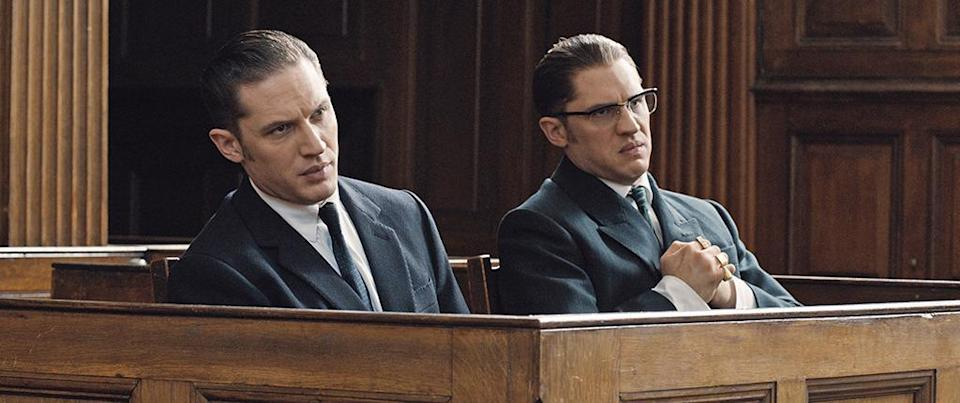 """<p>Much has been made about Tom Hardy's fight scenes in <a href=""""https://www.yahoo.com/movies/film/legend"""" data-ylk=""""slk:Legend"""" class=""""link rapid-noclick-resp""""><i>Legend</i></a>, in which <a href=""""https://www.yahoo.com/movies/watch-a-double-shot-of-tom-hardy-as-gangster-twins-122426727177.html"""" data-ylk=""""slk:he essentially bouts with himself;outcm:mb_qualified_link;_E:mb_qualified_link;ct:story;"""" class=""""link rapid-noclick-resp yahoo-link"""">he essentially bouts with himself</a>. In the film, he plays identical twin brothers, the notorious London gangsters Ronald and Reginald Kray. He filmed opposite a stunt double who really punched Hardy hard! <i>(Photo: Everett Collection)</i></p>"""