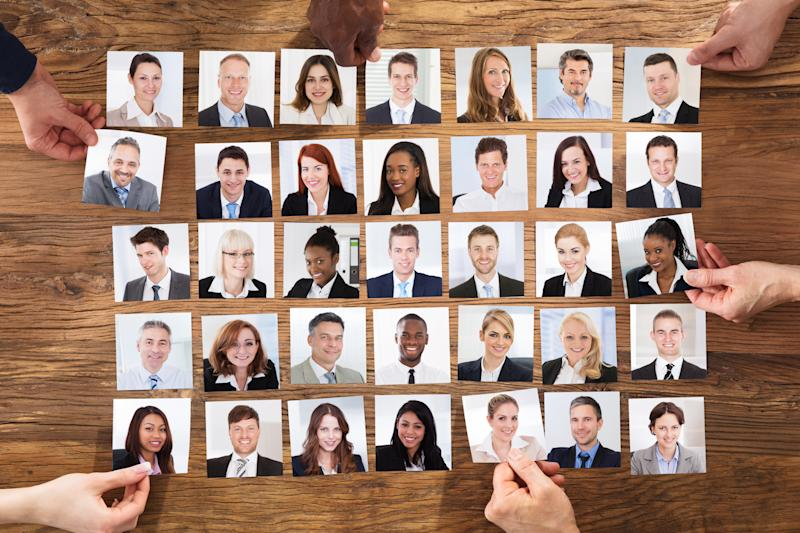 Businesspeople Hand Selecting The Candidate Portrait Photo For Hiring In Job