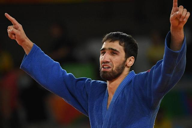 Russia's Khasan Khalmurzaev celebrates after defeating USA's Travis Stevens during their men's -81kg judo gold medal match in Rio de Janeiro on August 9, 2016 (AFP Photo/Toshifumi Kitamura)