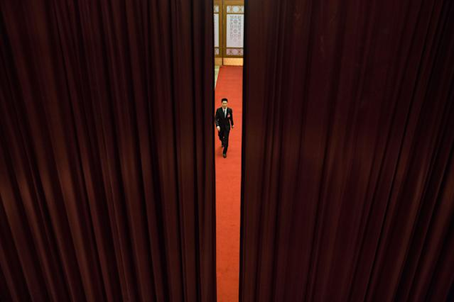 <p>A Chinese security officer stands guard during the second session of the 13th Chinese People's Political Consultative Conference (CPPCC) National Committee at the Great Hall of the People (GHOP) in Beijing on March 8, 2018. (Photo: Roman Pilipey/EPA-EFE/REX/Shutterstock) </p>
