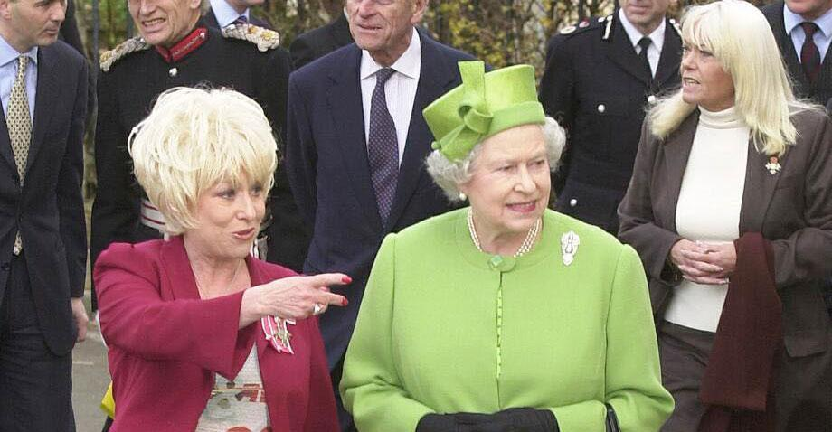 The Queen tours the EastEnders set with Barbara Windsor in 2001. (PA Images)
