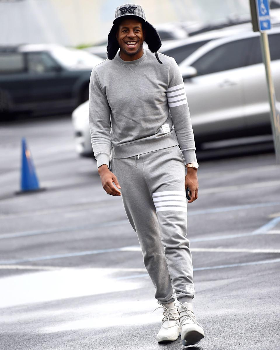 """<h1 class=""""title"""">March 6: Andre Iguodala</h1> <div class=""""caption""""> The Golden State Warrior tops off an elite Thom Browne fit with an even more elite furry hat. </div> <cite class=""""credit"""">Noah Graham</cite>"""