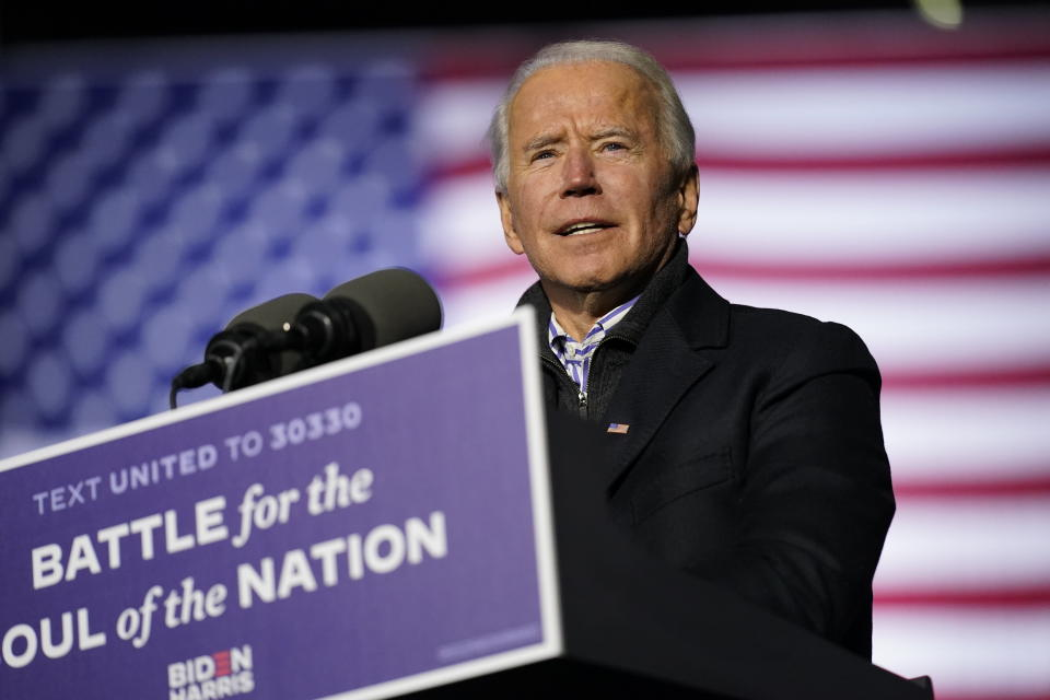 FILE - In this Nov. 2, 2020, file photo Democratic presidential candidate former Vice President Joe Biden speaks during a drive-in rally at Heinz Field in Pittsburgh. (AP Photo/Andrew Harnik, File)
