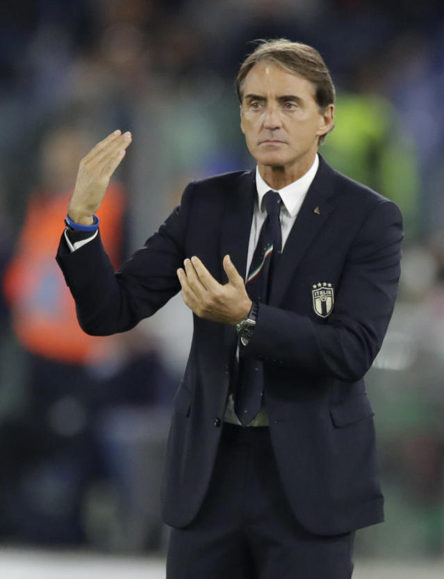 Italy coach Roberto Mancini gestures to his players during the Euro 2020 group J qualifying soccer match between Italy and Greece in Rome, Italy, Saturday, Oct. 12, 2019. (AP Photo/Alessandra Tarantino)