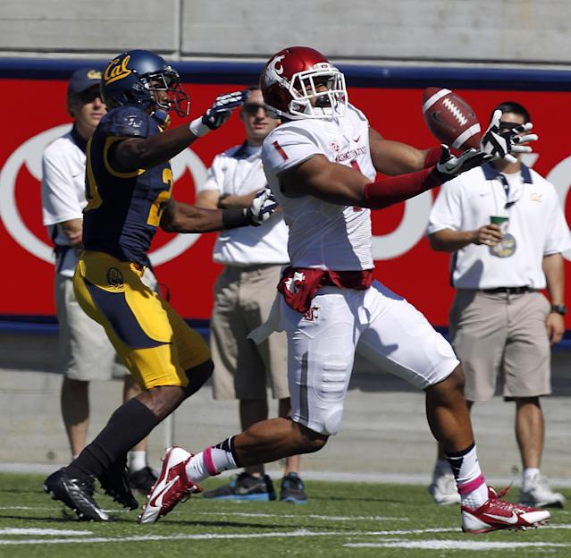 Washington State wide receiver Vince Mayle (1) catches a touchdown pass against California defensive back Isaac Lapite (20) during the first half of an NCAA college football game in Berkeley, Calif., Saturday, Oct. 5, 2013. (AP Photo/Tony Avelar)