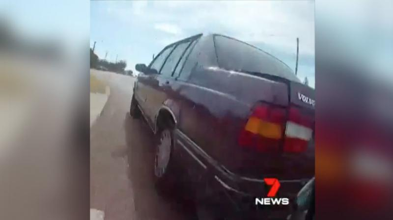 The footage appears to show the driver swerving in and out of the the cycling lane. Source: 7 News