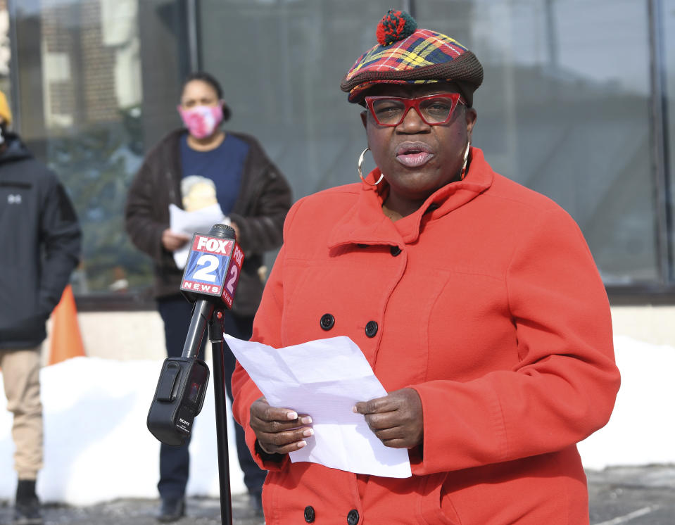 JeDonna Matthews Dinges, the victim of the hate attack, gives her remarks during the rally at St. Ambrose Church, Sunday, Feb. 21, 2021 in Grosse Pointe Park, Mich., following a white resident's display of a Ku Klux Klan flag in a side window facing her home. Dinges said the klan flag was hanging next door in a window directly across from her dining room. The incident occurred two weeks ago. (Clarence Tabb, Jr./Detroit News via AP)