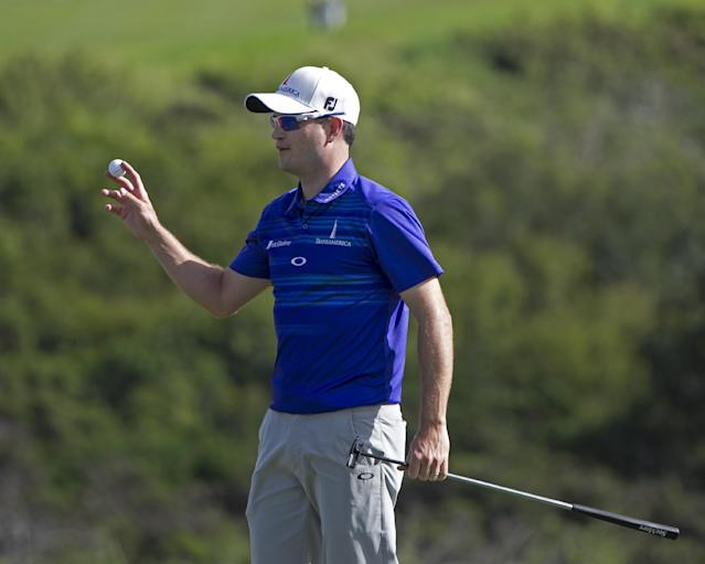 Zach Johnson waves to the gallery after winning the Tournament of Champions golf tournament, Monday, Jan. 6, 2014, in Kapalua, Hawaii. Johnson pulled away with three straight birdies on the back nine at Kapalua and closed with a 7-under 66 for a one-shot victory over Jordan Spieth on Monday. (AP Photo/Marco Garcia)