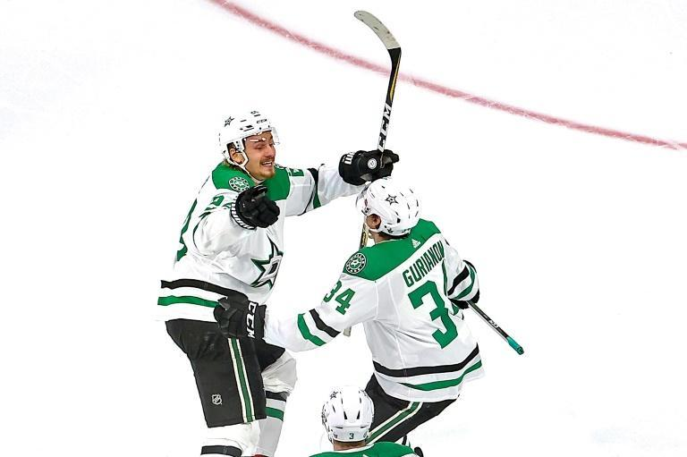 Dallas Stars forward Denis Gurianov (34) is congratulated by Roope Hintz after scoring the game-winning goal during overtime against the Vegas Golden Knights to win their Western Conference final series in five games