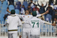 Pakistan pacer Shaheen Shah Afridi, center, celebrates with teammates after taking the wicket of Bangladesh batsman Mahmudullah during the first day of their 1st test cricket match at Rawalpindi cricket stadium in Rawalpindi, Pakistan, Friday, Feb. 7, 2020. (AP Photo/Anjum Naveed)