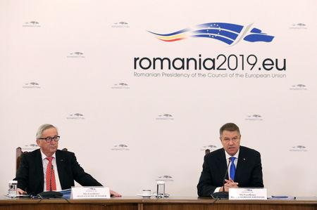 Romanian President Klaus Iohannis speaks next to European Commission President Jean-Claude Juncker in Bucharest, Romania, January 11, 2019. Inquam Photos/George Calin via REUTERS