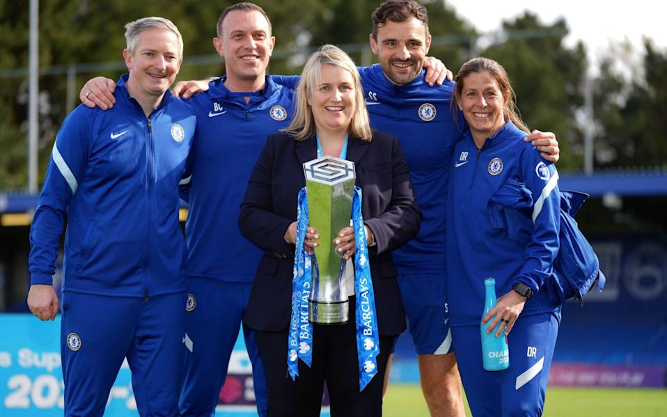 Chelsea manager Emma Hayes and her back room staff celebrate with the FA Women's Super League trophy - PA