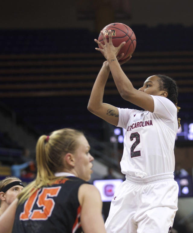 South Carolina's Olivia Gaines (2) shoots as Oregon State's Jamie Weisner defends during the first half of a second-round game in the NCAA women's college basketball tournament Tuesday, March 25, 2014, in Seattle. (AP Photo/Stephen Brashear)