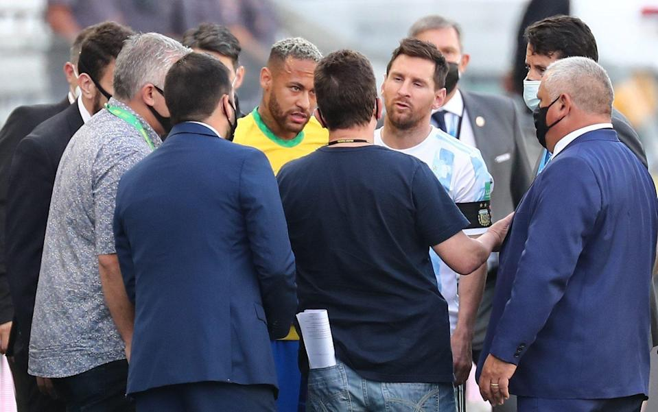 Neymar and Lionel Messi consult with Brazilian health officials mid-match - SHUTTERSTOCK