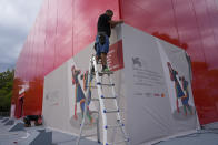 Workers set up the venue of the 78th edition of the Venice Film Festival at the Venice Lido, Italy, Monday, Aug. 30, 2021. (AP Photo/Domenico Stinellis)