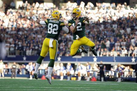 FILE PHOTO: Oct 8, 2017; Arlington, TX, USA; Green Bay Packers quarterback Aaron Rodgers (12) celebrates with tight end Richard Rodgers (82) after scoring the winning touchdown at AT&T Stadium. Mandatory Credit: Tim Heitman-USA TODAY Sports