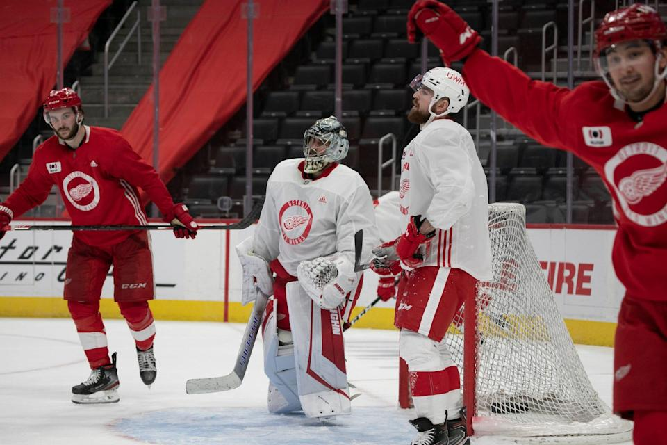 Detroit Red Wings' Team Red celebrates a go-ahead goal in the third period during a scrimmage Tuesday, Jan. 5, 2021 at Little Caesars Arena in Detroit.