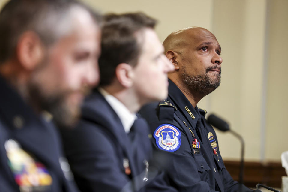 U.S. Capitol Police Sgt. Harry Dunn, right, watches a video being displayed during the House select committee hearing on the Jan. 6 attack on Capitol Hill in Washington, Tuesday, July 27, 2021. (Oliver Contreras/The New York Times via AP, Pool)