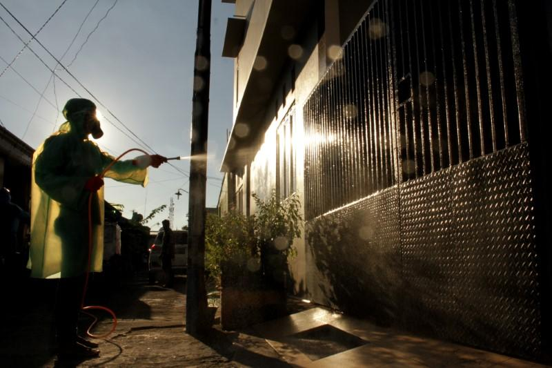 A worker spray disinfectant in a residential area, to prevent the spread of coronavirus disease (COVID-19)