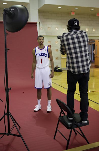 Philadelphia 76ers' Michael Carter-Williams poses for a photographer during NBA basketball media day at the team's practice facility, Friday, Sept. 27, 2013, in Philadelphia. (AP Photo/Matt Slocum)