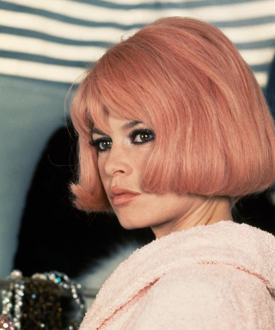 """<h3>Brigitte Bardot in </h3><em><h3>Two Weeks in September</h3></em><br>A classic Brigitte Bardot costume requires bright blonde hair — unless you go as her character in the 1967 film <em>Two Weeks in September</em>. The best part? You're still channeling her unique brand of <a href=""""https://www.refinery29.com/en-us/2020/10/10064938/emily-in-paris-french-girl-beauty-products-secrets"""" rel=""""nofollow noopener"""" target=""""_blank"""" data-ylk=""""slk:Parisian chic"""" class=""""link rapid-noclick-resp"""">Parisian chic</a>, just with a baby-pink bob and heavy <a href=""""https://www.refinery29.com/en-us/best-black-eyeliners"""" rel=""""nofollow noopener"""" target=""""_blank"""" data-ylk=""""slk:black eyeliner"""" class=""""link rapid-noclick-resp"""">black eyeliner</a>. Win-win!"""