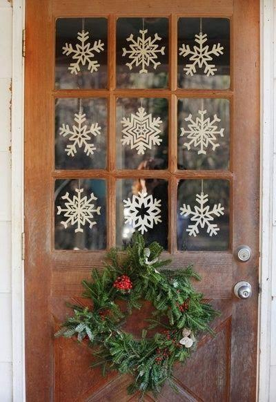 "<p>Pretty paper snowflakes are a sweet way to dress windowpanes for the chilly season. </p><p><em><a href=""http://nyclq-focalpoint.blogspot.com/2013/12/christmas-kitchen-decorating-ideas.html"" rel=""nofollow noopener"" target=""_blank"" data-ylk=""slk:See more at Focal Point Styling »"" class=""link rapid-noclick-resp"">See more at Focal Point Styling »</a></em></p>"