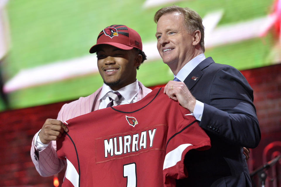 Cardinals quarterback Kyler Murray, left, stands on stage with NFL commissioner Roger Goodell after he was the first pick of the 2019 draft (AP Photo/Brandon Dill)