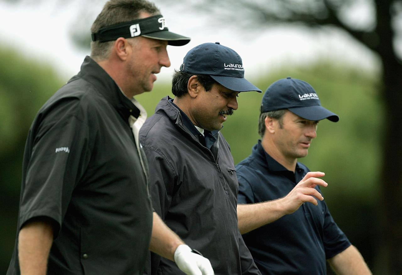 QUINTA DA MARINHA, PORTUGAL - MAY 9: Laureus Academy Members Ian Botham (L), Kapil Dev and Steve Waugh (R) walk down the fairway during the the Laureus golf challenge at the Oitavis Golf Club May 9, 2004 in Quinta Da Marinha, Portugal. (Photo by David Cannon/Getty Images for Laureus)
