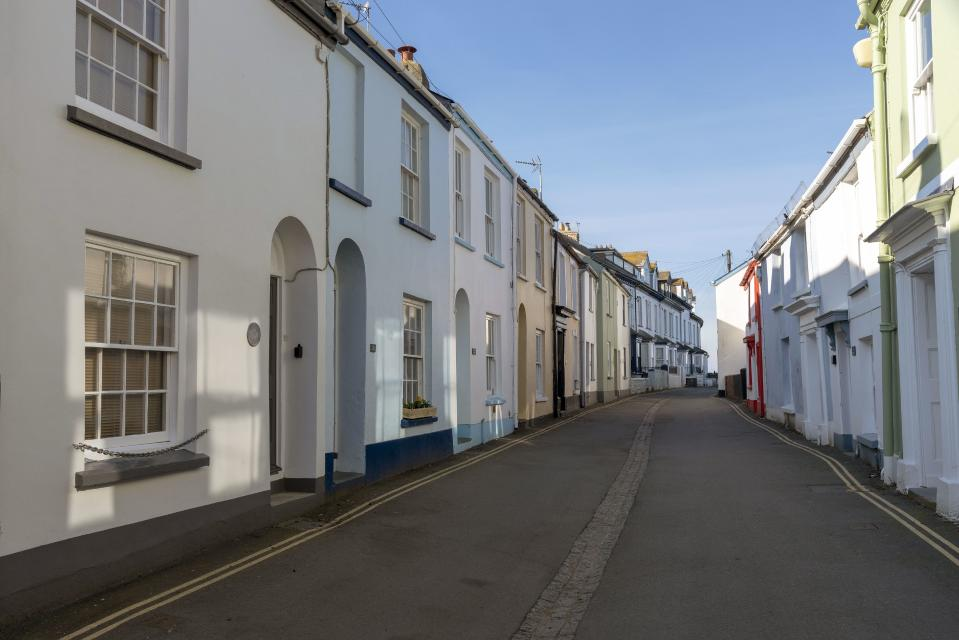 Appledore, North Devon, England, UK, Very narrow street of terraced homes in this popular seaside Devonshire town in winter. (Photo by: Peter Titmuss/Education Images/Universal Images Group via Getty Images)