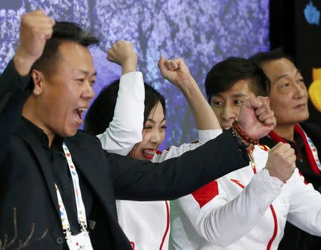 Figure Skating - ISU World Championships 2017 - Pairs Free Skating - Helsinki, Finland - 30/3/17 - Sui Wenjing and Han Cong of China and their team members react after the performance. REUTERS/Grigory Dukor