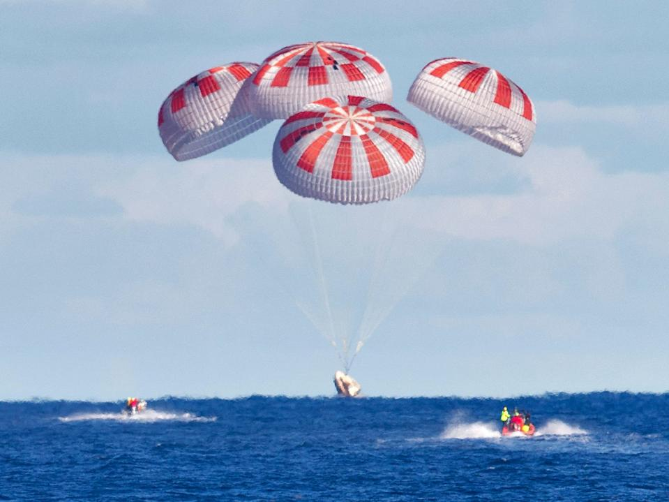 SpaceX's Crew Dragon is guided by four parachutes as it splashes down in the Atlantic Ocean about 200 miles off Florida's east coast on March 8, 2019, after returning from the International Space Station on the Demo-1 mission.