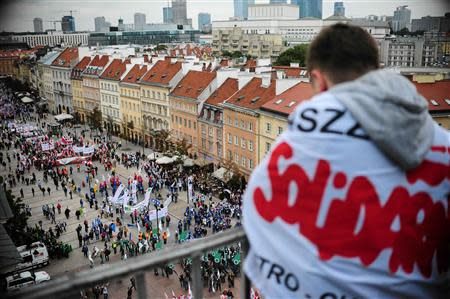 A protester from the Solidarity trade union looks down as people gather for an anti-government protest in Warsaw