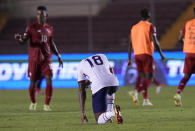 United State's Mark McKenzie, center, reacts after losing to Panama at the end of a qualifying soccer match for the FIFA World Cup Qatar 2022 at Rommel Fernandez stadium, Panama city, Panama, Sunday, Oct. 10, 2021. Panama won 1-0. (AP Photo/Arnulfo Franco)