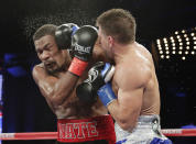 Ukraine's Sergiy Derevyanchenko punches Daniel Jacobs, left, during the eighth round of an IBF middleweight championship match Saturday, Oct. 27, 2018, in New York. Jacobs won the fight. (AP Photo/Frank Franklin II)