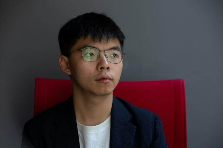 """Hong Kong pro-democracy activist Joshua Wong, posing for a photo after an interview with AFP, has been arrested and jailed but says that's a """"really small"""" price (AFP Photo/Alastair Pike)"""