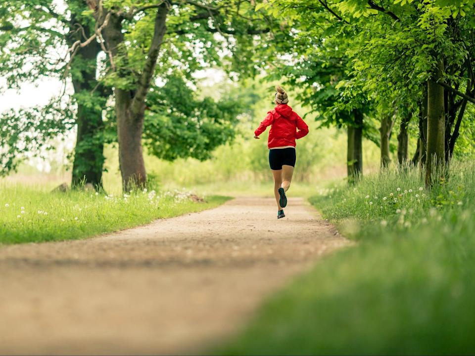 Woman runs outside (Getty Images/iStockphoto)