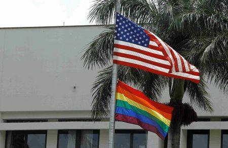 The flag of diversity flutters at the U.S. Embassy in San Jose, Costa Rica, as a show of support for the lesbian, gay, bisexual, and transgender (LGBT) community in Costa Rica, June 3, 2016. REUTERS/Juan Carlos Ulate/File Photo