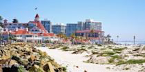 """<p><strong>Best for Families </strong> <br></p><p>Located on Coronado Island, just over the bridge from <a href=""""https://www.bestproducts.com/fun-things-to-do/a25607779/things-to-do-in-san-diego/"""" rel=""""nofollow noopener"""" target=""""_blank"""" data-ylk=""""slk:San Diego"""" class=""""link rapid-noclick-resp"""">San Diego</a>, family-friendly <a href=""""https://go.redirectingat.com?id=74968X1596630&url=https%3A%2F%2Fwww.tripadvisor.com%2FAttraction_Review-g32250-d117411-Reviews-Coronado_Municipal_Beach-Coronado_California.html&sref=https%3A%2F%2Fwww.redbookmag.com%2Flife%2Fg37132327%2Ftop-california-beach-vacations%2F"""" rel=""""nofollow noopener"""" target=""""_blank"""" data-ylk=""""slk:Coronado Beach"""" class=""""link rapid-noclick-resp"""">Coronado Beach</a> is a wide stretch with calm waters. Named one of Dr. Beach's <a href=""""http://drbeach.org/online/2018-top-10-beaches/"""" rel=""""nofollow noopener"""" target=""""_blank"""" data-ylk=""""slk:Top 10 Beaches in 2018"""" class=""""link rapid-noclick-resp"""">Top 10 Beaches in 2018</a>, Coronado is also home to the famous red-roofed, Victorian-style <a href=""""https://go.redirectingat.com?id=74968X1596630&url=https%3A%2F%2Fwww.tripadvisor.com%2FHotel_Review-g32250-d125137-Reviews-Hotel_del_Coronado-Coronado_California.html&sref=https%3A%2F%2Fwww.redbookmag.com%2Flife%2Fg37132327%2Ftop-california-beach-vacations%2F"""" rel=""""nofollow noopener"""" target=""""_blank"""" data-ylk=""""slk:Hotel del Coronado"""" class=""""link rapid-noclick-resp"""">Hotel del Coronado</a>, affectionately known as the Del. </p><p><em><strong>Where to Stay:</strong> </em><a href=""""https://go.redirectingat.com?id=74968X1596630&url=https%3A%2F%2Fwww.tripadvisor.com%2FHotel_Review-g32250-d125137-Reviews-Hotel_del_Coronado-Coronado_California.html&sref=https%3A%2F%2Fwww.redbookmag.com%2Flife%2Fg37132327%2Ftop-california-beach-vacations%2F"""" rel=""""nofollow noopener"""" target=""""_blank"""" data-ylk=""""slk:Hotel del Coronado"""" class=""""link rapid-noclick-resp"""">Hotel del Coronado</a>, <a href=""""https://go.redirectingat.com?id=74968X1596630&url=https%3A%2F%2Fww"""