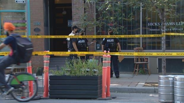 Police say they were called to the King Street East and Sherbourne Street area just before 2 p.m. after a man entered a workplace there and stabbed an employee.  (Peter Turek/CBC - image credit)