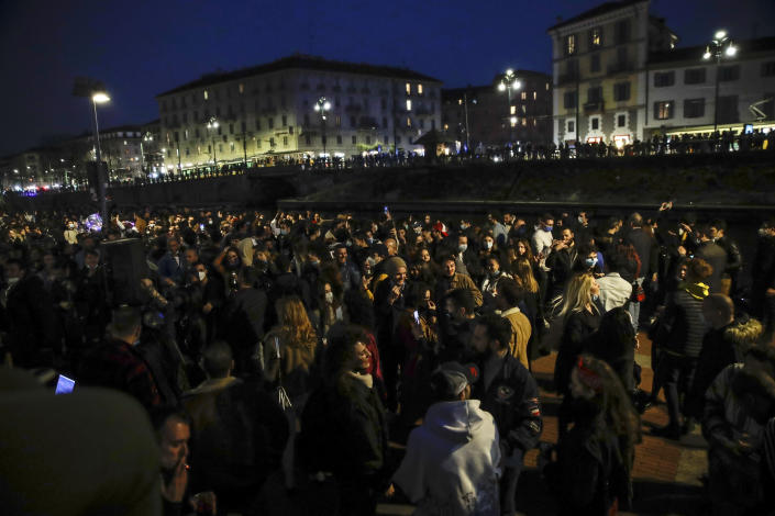 FILE - In this Saturday, Feb. 27, 2021 file photo, people gather at the Darsena dei Navigli, in Milan, Italy. Europe recorded 1 million new COVID-19 cases last week, an increase of 9% from the previous week and ending a six-week decline, WHO said Thursday, March 4, 2021. The so-called UK variant is of greatest concern in the 53 countries monitored by WHO in Europe. (AP Photo/Luca Bruno, File)